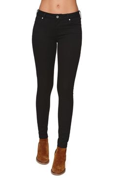 """The women's Bullhead Denim Co Low Rise Skinniest Starry Black Jean is the perfect black jean. It is our perfect low rise skinniest fit, with NEW ultra stretch fabric and a super soft hand feel. It has a button and zip fly front. These perfect fitting jeans are a wardrobe staple. We love pairing these jeans with a t-shirt during the day, or with a fashion top for a night out!Low rise8"""" rise3 Long: 32"""" inseam3 Reg: 30"""" inseamModel is wearing a 3 RegHer measurements: ..."""