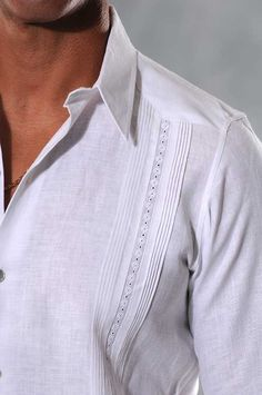 Unique Design Guayabera dress shirt. Exclusive Guayaberas Cubanas Design. Nacar Button. - Premium Hight Quality Italian Linen Guayabera. Exclusive Guayaberascubanas design.These Mexican wedding shirts are long sleeves with French cuff, DO NOT come with cuff links. Cuff Links available in this web. Dry Clean for best result. A classic an sublimely soft Linen 100 %. Availability is subject to change, Maybe requires approximately  2-3 weeks to receive. PANTS available.