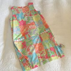 New condition Lilly Pulitzer patchwork dress Bought it too big, so asking what I paid for it! Love this patchwork pattern. New condition - I never wore it and bought it from someone who wore it once or twice. 100% Cotton. True to size. May trade for same condition Lilly! Lilly Pulitzer Dresses Mini