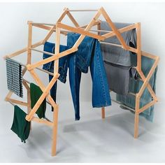 "Extra-Large Arch Drying Rack $129.95 unique shape enable you to dry more clothes, faster. Its full arch allows air to circulate around wet clothing for quicker, more even drying. Ideal for use outdoors or inside; added air circulation. Crafted of solid wood with clear vinyl tubing over wooden dowels to eliminate marks on clothing and prevent mildew. 52""Hx30-1⁄2""Wx57-1⁄2""L (upright), 19""Hx19""Wx29""L (folded) Dowels 3⁄4""OD 18-1⁄2 lb. USA made by the Amish."