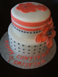 Two tier red velvet with Lobster Tail Filling, coral, grey and white marshmallow fondant with flower design for confirmation.