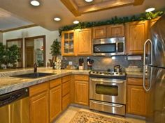Granite and Stainless Appliances in Kitchen with Oak Cabinets