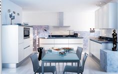 White Wall Cabinet Design With Mini Wall Lighting And Glass Dining Table With Four Chairs In Glossy White Kitchen