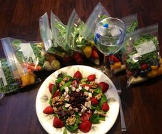 Today's G-Bombs salad surrounded by this weeks prepackaged smoothie ingredients via Kathleen Harron! #Stayorganized #MM90DAY