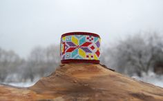 This bright and colorful seed bead leather cuff bracelet can be great accent to your every day look. It is comfortable to wear and displays beautifully.  It is handmade with ancient Latvian (Baltic) ornament - symbol of morning star called - Auseklis.  Auseklis, is the emblem of the morning star in the Baltic region- the Latvian God Auseklis. The symbol represents planet Venus.  Latvians believed that star as a symbol protects people from evil and danger.  Made in loom bead technique with…