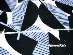 Bold designer black and blue leaves Graphic pattern cotton fabric by the yard. $8.00, via Etsy.