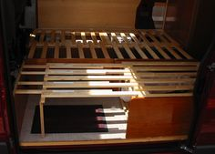 Bed extended - using two sets of sliding slats to extend frame length. Small inner sliding slats as well as large sliding slats allows total bed length to be more than double the fold away length.