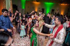 Indian couple and wedding guests dancing photography http://www.maharaniweddings.com/gallery/photo/106980 @electrickarma @chrismbrock/wedding-photography @electrickarma