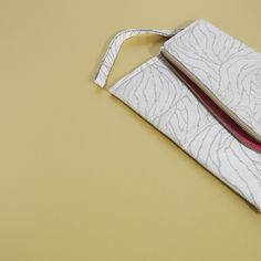 IMAN leather clutch in light grey