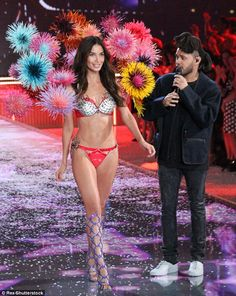 Gaudy: The bra featured 14 different gems - including red garnet, blue topaz, yellow sapphire, and pink quartz - which are all set in 18 karat gold as she walked past The Weeknd, who was one of the performers of the night