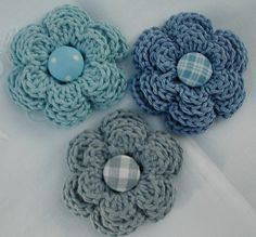 Crochet flowers with plaid button centers