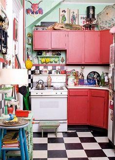 Wonderful kitchen, red cabinets, vintage stove, black and white floor, kitsch decor