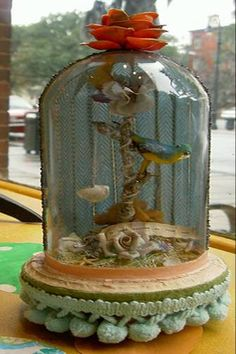 bird vignette in a cloche.  good idea for a bottle.  glue metal rose to cork