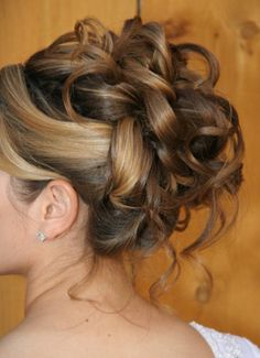 My dream wedding hair but up higher and tiara with tons of sparkles added