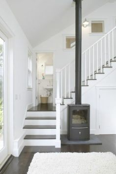 This compact woodstove makes a warm fire possible in the last place anyone I cou… – Freestanding fireplace wood burning Foyers, Wood Burning Logs, Modern Entry, Pellet Stove, Gas Stove, Freestanding Fireplace, Log Burner, White Rooms, White Walls