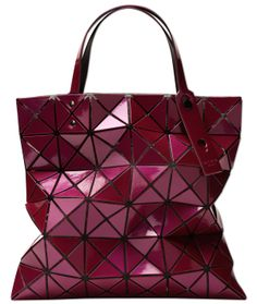 d71f35a99bf TOTE BAO BAO ISSEY MIYAKE This open TOTE bag features larger triangles  placed on mesh fabric.