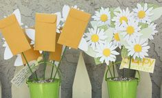 Excellent teacher gift idea.  The envelopes attached to the flowers hold gift cards. :)