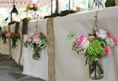 Use old mason jars to hold floral centerpieces just like these beautiful rustic style arrangements