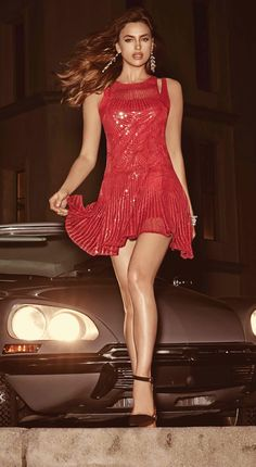 Great look and the dress if fabulous - even the garter belt is peeking through for added excitement.