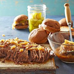Pack some tang and heat into this brisket with beer and chili sauce. Fork slices of meat onto kaiser rolls for a hearty sandwich.