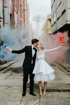 bride and groom with colour smoke bombs - epic Sydney wedding by Lara Hotz photography