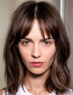 A gentle middle part with a little peek of forehead makes your fringe hairstyle look effortlessly messy + boho.