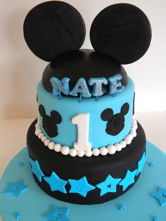 Mickey Mouse - two tier chocolate cake, chocolate butter cream filled, fondant covered I had seen alot of minnie cakes in this style but no blue boys ones..this one was a hit with the birthday boy.