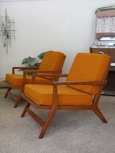 Pair of Mid Century Modern Lounge Chairs. Original Orange Fabric. Retro Style Oak Frame. $2,495.00, via Etsy.