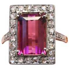 Edwardian Tourmaline Diamond Ring. A rectangular gold ring set with a bright pink tourmaline surrounded by small rose cut diamonds set in platinum (app. 0.6 carats), circa 1910.