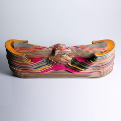 For over a decade, self-taught woodcarver Haroshi has been recycling old skateboard decks into magnificent multilayered works of art. Stacking, shaving, cu