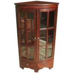 This furniture can be used as a curio, bookcase or cabinet for your books or collections. This mahogany wood corner cabinet can fit into any office, living room, family room, or even dining room decor.