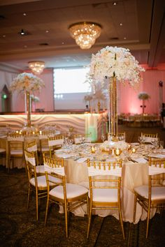 Tall centerpieces in white flowers, crystals & gold | Glamorous Seaside Wedding In Champagne & Blush Tones With Gatsby Like Art Deco Flair | Photograph by Off Beet Productions http://www.storyboardwedding.com/sophisticated-new-jersey-wedding-celebration-great-gatsby/