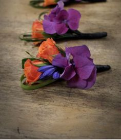 Boutonnière~Orange, blue and plum