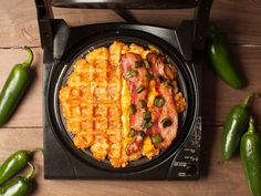 Bring your grilled cheese to the next level by pressing tater tots into a waffle iron, covering them with cheese, bacon, and jalapeño slices, then pressing another layer of tater tots on top.