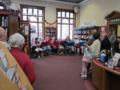 A performance by local ukelele enthusiasts who practice each week as part of an Age UK group,  in Crown Street Library, Darlington