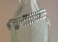 #4004B Wrap style, Swarovski ClearAB crystals, pewter with SS overlay beads.