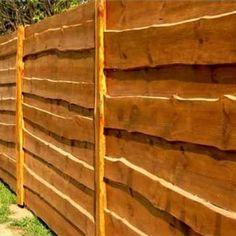 Забор из необрезной доски в нахлест