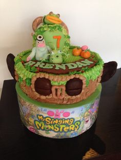 "Fantasy cake - ""My Singing Monsters"". Chocolate chiffon cake with caramel fudge filling, Butter cream frosting, gum paste decorations."