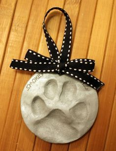 Check out this homemade dog paw print ornament! An easy DIY project to include your pets in the holiday festivities. Noel Christmas, Diy Christmas Ornaments, Homemade Christmas, Holiday Crafts, Holiday Fun, Christmas Decorations, Dog Ornaments, Couple Ornaments Diy, Our First Christmas Ornament