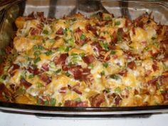 "Loaded Potato and Chicken Casserole  2 pounds boneless chicken breasts, cubed (1"")  8-10 medium potatoes, cut in 1/2"" cubes  1/3 cup olive oil  1&1/2 tsp salt  1 Tbsp. black pepper  1 Tbsp. paprika  2 Tbsp. garlic powder  6 Tbsp. hot sauce    Topping:  2 cups fiesta blend cheese  1 cup crumbled bacon  1 cup diced green onion"