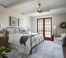 To keep this master suite feeling peaceful and relaxing, I went with soft, neutral walls, whitewashed beams on the ceiling, and medium stained wood doors.