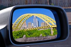 Objects in Mirror are Closer Than They Appear.  Cincinnati's skyline and Daniel Carter Beard Bridge seen in car sideview mirror from Newport, Kentucky.