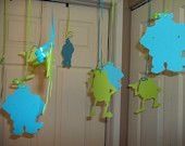Monsters Inc Inspired Ceiling Silhouette Decorations by MonarchPaperCreation. So cute to hang with opposite color curling ribbon from the ceiling! I love these and very easy to DIY and print and cut at home on card stock!