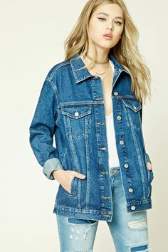 A denim jacket featuring a button front, basic collar, two front flap button pockets, front slit pockets, long button cuff sleeves, and an oversized silhouette.