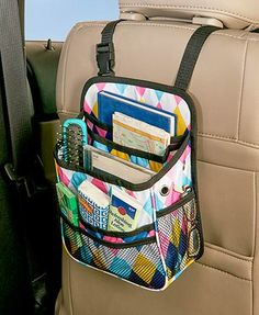 Store important items on the go with this Backseat Car Organizer. It has an adjustable strap that you can hang on the headrest of any front seat, providing storage space to a backseat passenger. It has a total of 11 compartments--2 mesh side compartments, 2 mesh pen holders, 2 additional mesh compartments, 4 regular compartments for miscellaneous items and a zippered pocket on back.