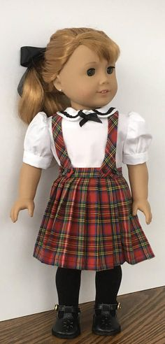 A pretty skirt set for your doll. The skirt is made from a red, black, yellow, green and blue fabric. Pleats go around the skirt. Three snaps close the skirt in the back. The straps are attached in the front with small black buttons and snap to the skirt in the back. The blouse is