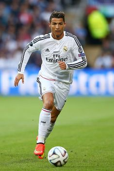 Cristiano Ronaldo of Real Madrid runs with the ball during the UEFA Super Cup between Real Madrid and Sevilla FC at Cardiff City Stadium on August 12, 2014 in Cardiff, Wales.
