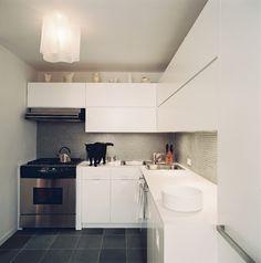 Black (cat) and white kitchen