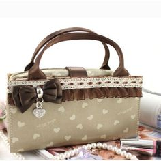 "Hearts and Lace 2-in-1 Cosmetic Bag Beige by JewelryNanny. $14.00. Spacious interior. Cute and flirty design. Dimensions: 7"" x 9"" x 2"". Durable and High Quality; Made of polyester & PVC . Perfect for travel and on-the-go. Hearts and Lace 2-in-1 Cosmetic Bag features a cosmetic pouch integrated into a handbag, which makes it easy to carry all your make up essentials. Heart pattern with lace trim and bow accent.. Save 50% Off!"