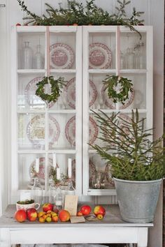 Cupboard made from old windows! apples, pine, candles in old bottles -- VIBEKE DESIGN: